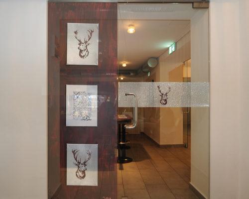 Folierung Glastüre Kunstcafe